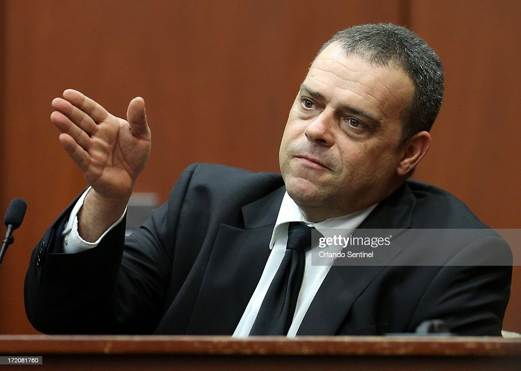 Sanford police officer Chris Serino identifies George Zimmerman in the courtroom during the Zimmerman trial in Sanford, Florida, Monday, July 1, 2013. Zimmerman is accused in the fatal shooting of Trayvon Martin.