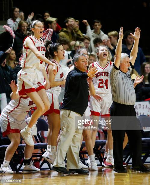 Sanford vs Scarborough girls Class AA South basketball semifinal. The Scarborough bench celebrates a three-point basket by Lindsay Fiorillo in the...