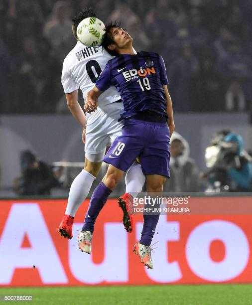 Sanfrecce Hiroshima defender Sho Sasaki fights for the ball with Auckland City FC midfielder Darren White during their FIFA Club World Cup football...