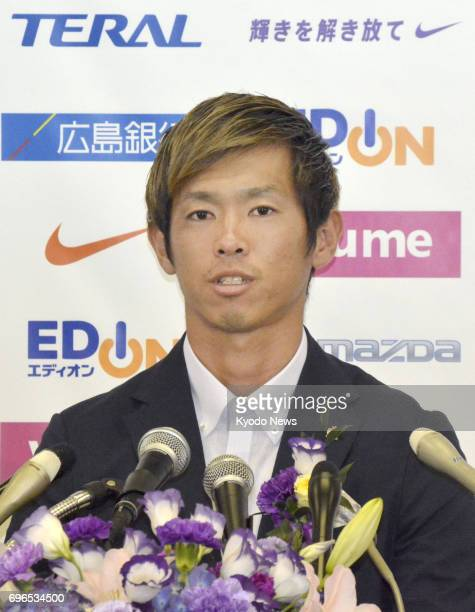 Sanfrecce Hiroshima defender Tsukasa Shiotani attends a press conference in Hiroshima on June 16 after signing a twoyear deal with 2003 Asian...