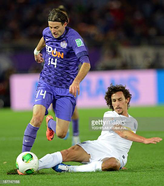 Sanfrecce Hiroshima midfielder Mihael Mikic fights for the ball with Auckland City midfielder Albert Riera during their FIFA Club World Cup 2012 M1...