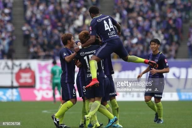 Sanfrecce Hiroshima players celebrate their first goal scored by Kosei Shibasaki during the J.League J1 match between Sanfrecce Hiroshima and FC...