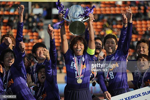 Sanfrecce Hiroshima players celebrate with the trophy after the Xerox Super Cup match between Sanfrecce Hiroshima and Kashiwa Reysol at the National...