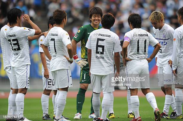 Sanfrecce Hiroshima players talk during the JLeague match between Yokohama FMarinos and Sanfrecce Hiroshima at Nissan Stadium on October 6 2012 in...