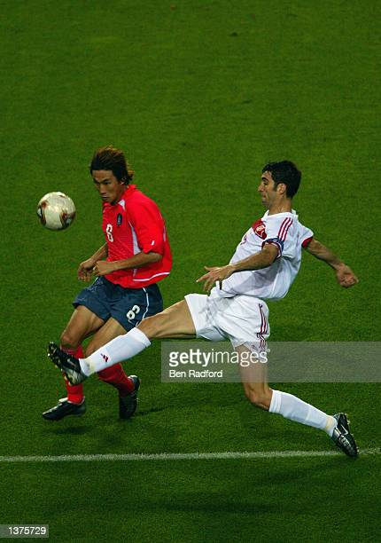 Sang Chul Yoo of South Korea takes the ball past Hakan Sukur of Turkey during the FIFA World Cup Finals 2002 Third Place PlayOff match played at the...