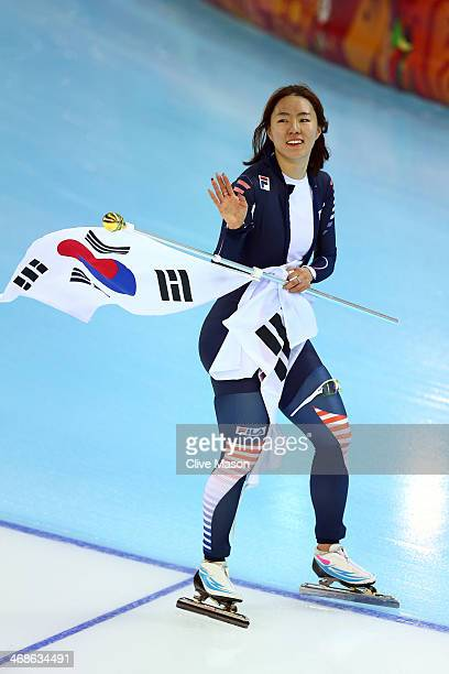 Sang Hwa Lee of South Korea celebrates winning the gold medal during the Women's 500m Race 2 of 2 Speed Skating event during day 4 of the Sochi 2014...