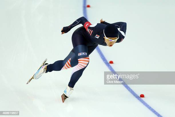 Sang Hwa Lee of South Korea competes during the Women's 500m Race 1 of 2 Speed Skating event during day 4 of the Sochi 2014 Winter Olympics at Adler...