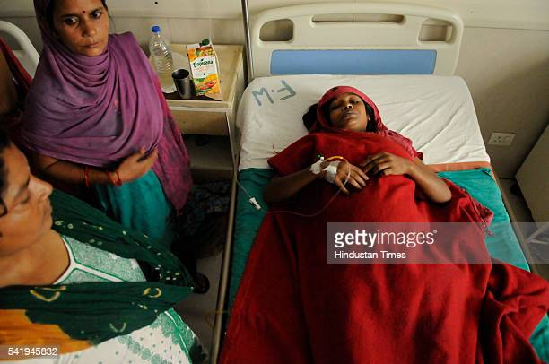 Sangeeta Devi lies on bed at government district hospital on June 21, 2016 in Noida, India. The family of Sangeeta alleged that she delivered twins...