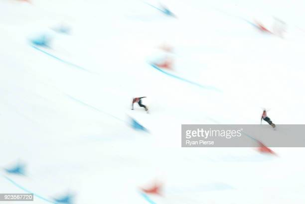 Sangho Lee of Korea and Dmitry Loginov of Olympic Athlete from Russia compete during the Men's Parallel Giant Slalom Run on day fifteen of the...