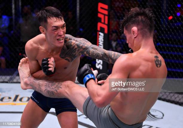 Sanghoon Yoo punches Peter Barrett in their lightweight bout during Dana White's Contender Series season three week 10 at the UFC Apex on August 27...