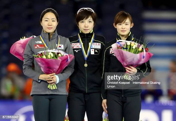 SangHwa Lee of Korea poses during the medal ceremony after winning the 2nd place Nao Kodaira of Japan poses during the medal ceremony after winning...
