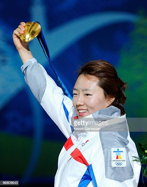 SangHwa Lee of South Korea celebrates with her gold medal during the medal ceremony for the Ladies' 500m Speed Skating on day 6 of the Vancouver 2010...