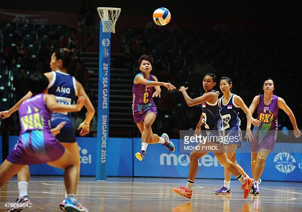 Sangjan Pacharee of Thailand passes the ball against Singapore during the netball women semifinal match 17 at the 28th Southeast Asian Games in...