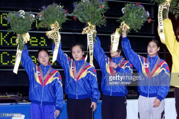 Sang-mi An, Min-Jin Joo, Hye-won Park and Min-Kyung Choi of Korea present their silver medals 12 March 2000, after the women's 3000m relay during the...