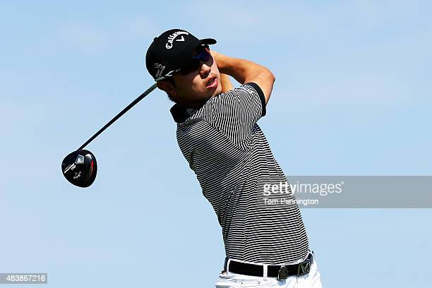 SangMoon Bae of Korea watches his tee shot on the 14th hole during the first round of the 2015 PGA Championship at Whistling Straits on August 13...
