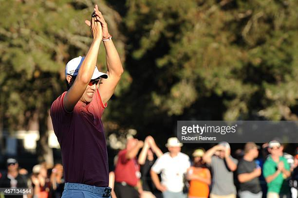 Sang-Moon Bae of South Korea acknowledges the crowd on the 18th green in the final round of the Frys.com Open at Silverado Resort and Spa on October...