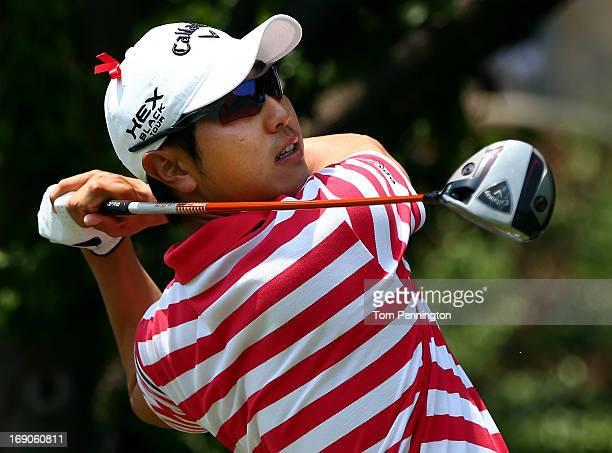 Sang-Moon Bae of South Korea hits a shot during the final round of the 2013 HP Byron Nelson Championship at the TPC Four Seasons Resort on May 19,...