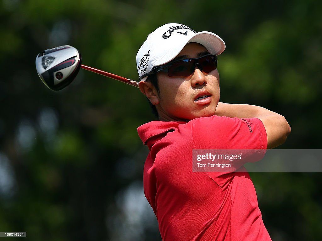 Sang-Moon Bae of South Korea hits a shot during the third round of the 2013 HP Byron Nelson Championship at the TPC Four Seasons Resort on May 18, 2013 in Irving, Texas.