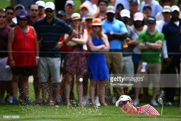 Sang-Moon Bae of South Korea hits a shot out of a sand trap during the final round of the 2013 HP Byron Nelson Championship at the TPC Four Seasons...