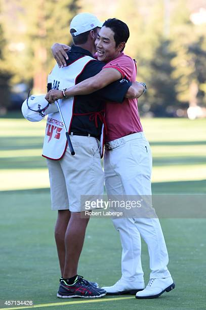 Sang-Moon Bae of South Korea hugs his caddy on the 18th green after winning the Frys.com Open at Silverado Resort and Spa on October 12, 2014 in...