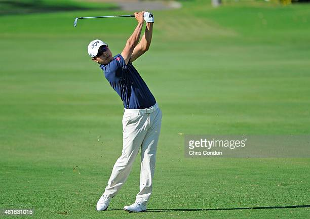 SangMoon Bae of South Korea plays his second shot from a fairway bunker on the second hole during the third round of the Sony Open in Hawaii at...