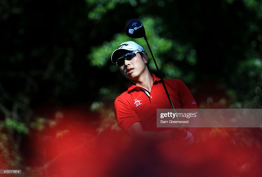 Sangmoon Bae of South Korea plays his shot from the 15th tee during round three of THE PLAYERS Championship at the TPC Sawgrass Stadium course on May 9, 2015 in Ponte Vedra Beach, Florida.