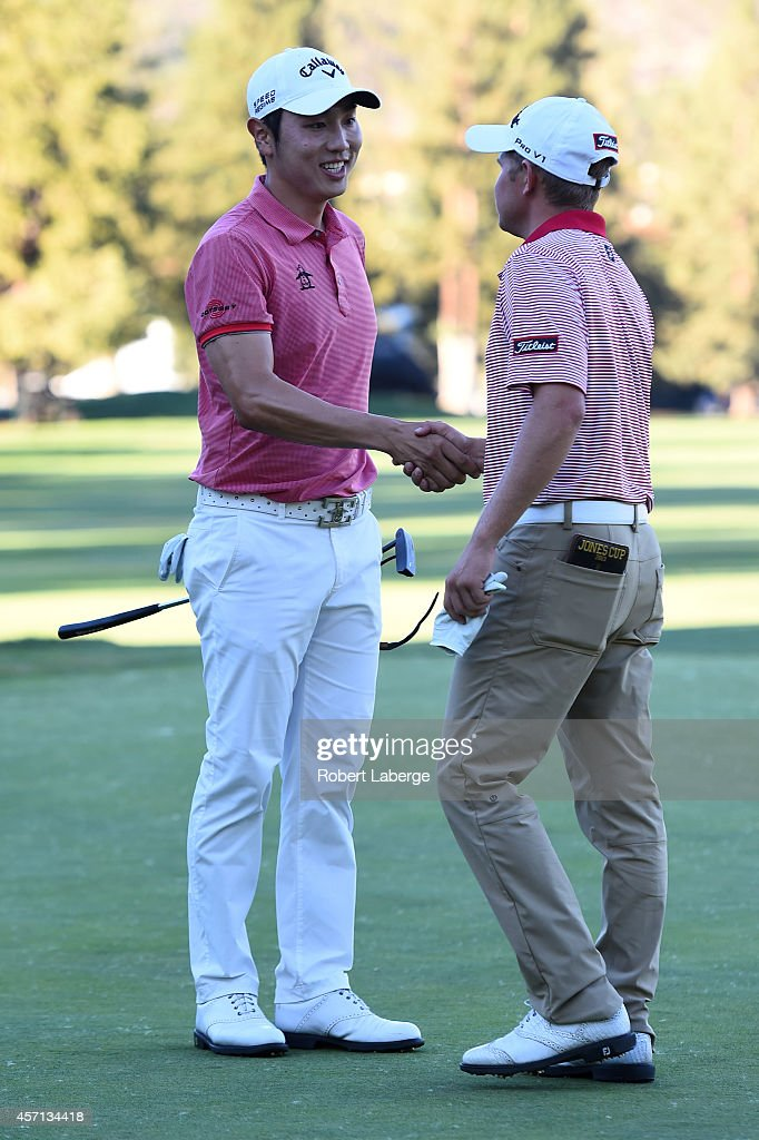 Sang-Moon Bae of South Korea shakes hands with Zachary Blair on the 18th green after winning the Frys.com Open at Silverado Resort and Spa on October 12, 2014 in Napa, California.
