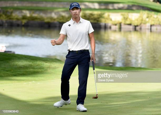 Sangmoon Bae of the Republic of Korea reacts after sinking his birdie putt on the 17th hole during the third round of the Albertsons Boise Open at...