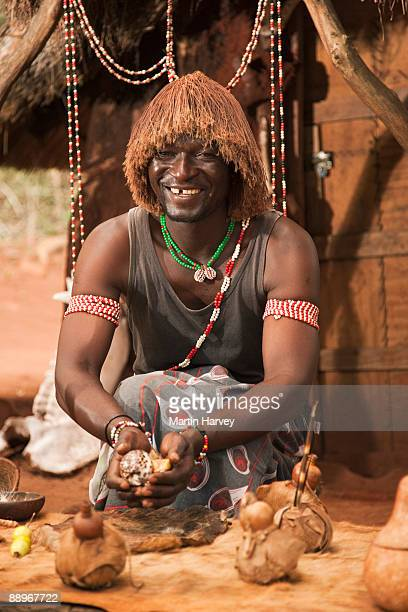 sangoma (traditional healer) throwing bones. - african witch doctor stock photos and pictures