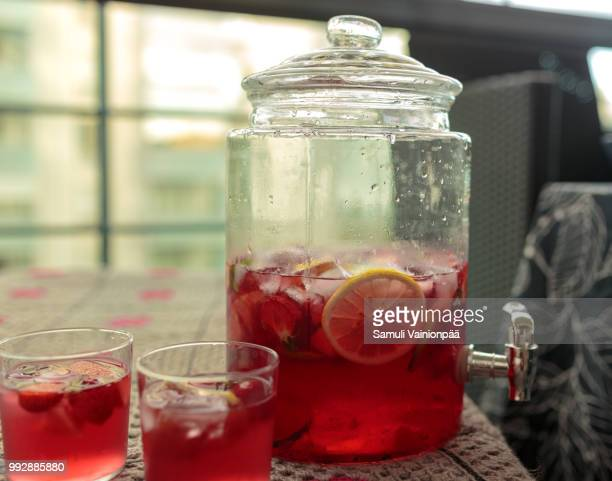 sangria inside of glass jar with a tap - sangria stock pictures, royalty-free photos & images