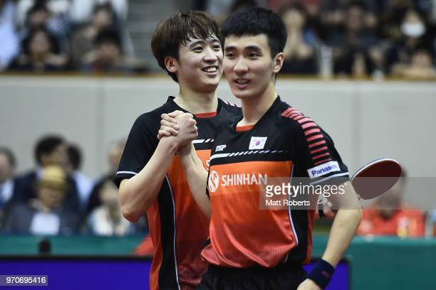 Sangsu Lee and Youngsik Jeoung of South Korea celebrates winning the men's doubles final against Kai Zhou and Jingkun Liang of China on day three of...