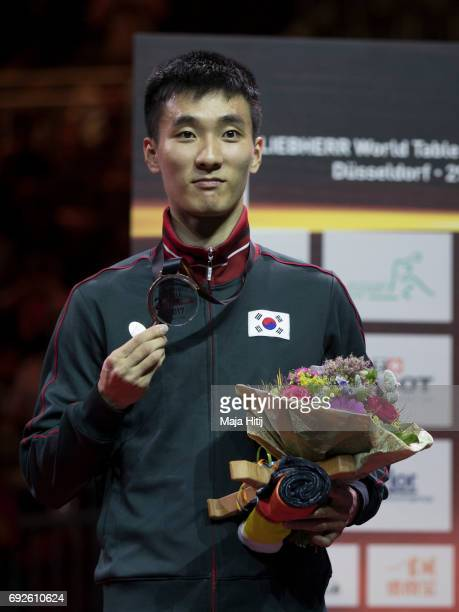 Sangsu Lee of South Korea celebrates with a bronze medal during celebration ceremony of Men's Singles Final at Table Tennis World Championship at...