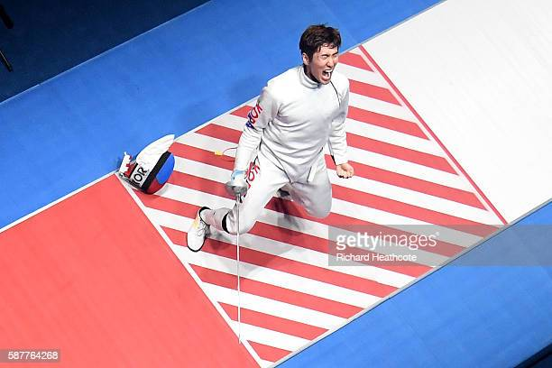 Sangyoung Park of Korea celebrates after defeating Geza Imre of Hungary during the gold medal medal bout in the Men's Epee Individual on Day 4 of the...