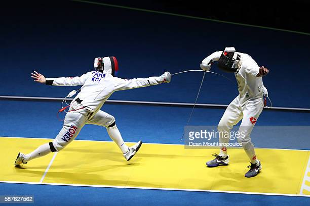 Sangyoung Park of Korea in action against Max Heinzer of Switzerland during the quarterfinal in the Men's Epee Individual on Day 4 of the Rio 2016...