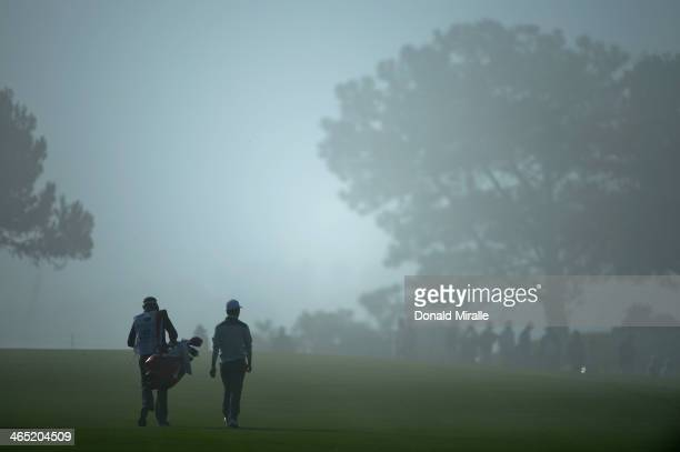 Sang-Yul Noh walks on the second fareway during the final round of the Farmers Insurance Open on Torrey Pines South on January 26, 2014 in La Jolla,...