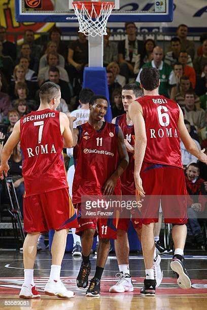 Sani Becirovic #7 Brandon Jennings #11 Rodrigo de la Fuente #14 and Angelo Gigli #6 all of Lottomatica Roma celebrate during the Euroleague...