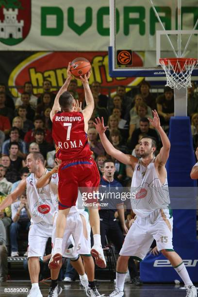 Sani Becirovic #7 of Lottomatica Roma shoots as Marko Milic #12 and Mirza Begic #15 of Union Olimpija defend during the Euroleague Basketball Game 3...
