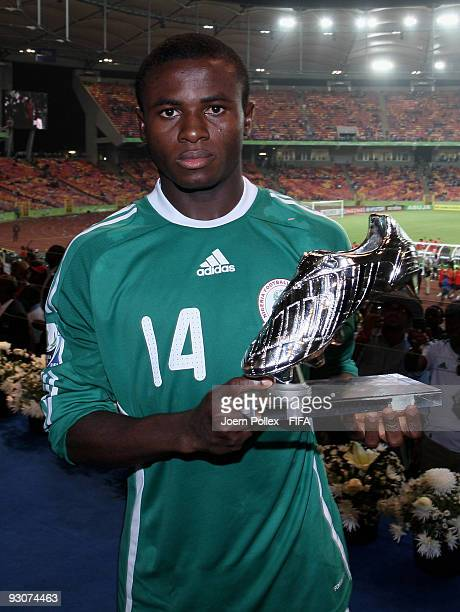 Sani Emmanuel of Nigeria pose with the Silver Shoe Trophy after the FIFA U17 World Cup Final between Switzerland and Nigeria at the Abuja National...