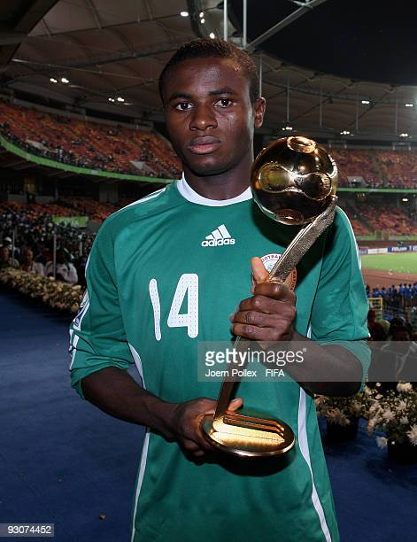 Sani Emmanuel of Nigeria poses with the golden ball award after the FIFA U17 World Cup Final between Switzerland and Nigeria at the Abuja National...