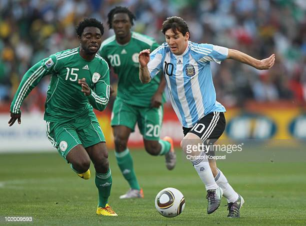 Sani Kaita of Nigeria chases Lionel Messi of Argentina during the 2010 FIFA World Cup South Africa Group B match between Argentina and Nigeria at...