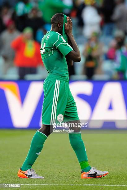 Sani Kaita of Nigeria covers his face as he walks off the pitch after being shown a red card during the 2010 FIFA World Cup South Africa Group B...