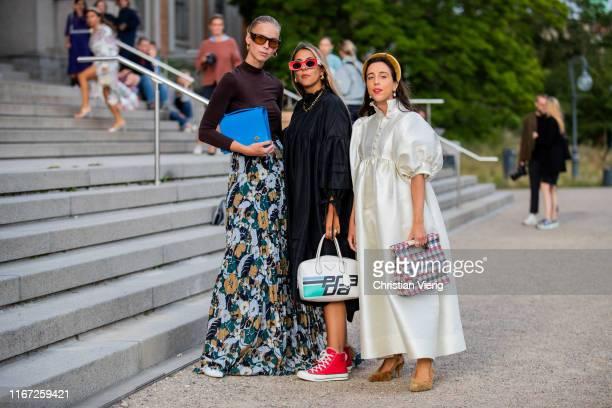 Sania Claus Demina wearing creme white dress, Hanna Mw wearing black dress, Prada bag and Hilda Sandström wearing brown longshirt skirt with floral...