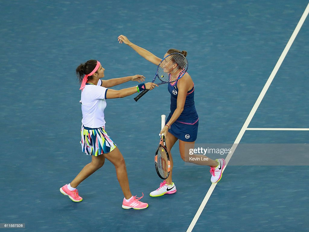 Sania Mirza and Barbora Strycova of Czech Republic celebrate after winning the semi-final match against Hao-Ching Chan of Chinese Taipei and Yung-Jan Chan of Chinese Taipei on day 6 at Optics Valley International Tennis Center on September 30, 2016 in Wuhan, China.