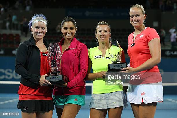 Sania Mirza and Bethanie MattekSands hold the winners trophy while their opponents AnnaLena Groenefeld and Kveta Peschke hold the runners up trophy...