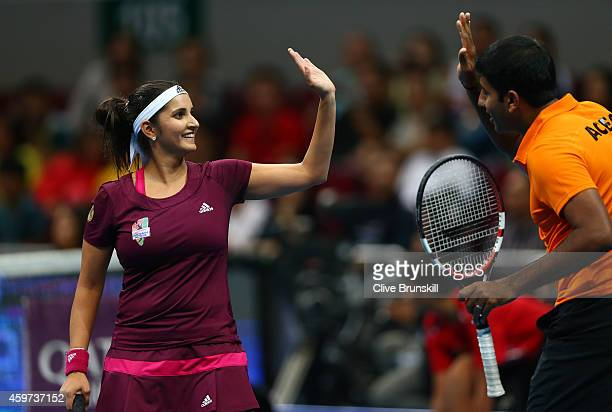 Sania Mirza and Rohan Bopanna of the Indian Aces celebrate match point against Nenad Zimonjic and Kristina Mladenovic of the UAE Royals during the...