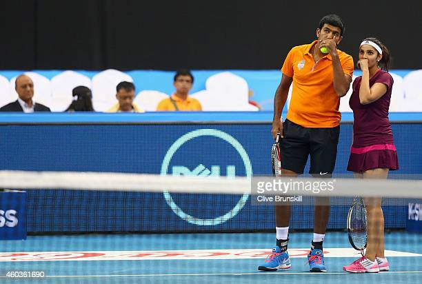 Sania Mirza and Rohan Bopanna of the Indian Aces discuss tactics during their victory against Kirsten Flipkens and Daniel Nestor of the Manila...