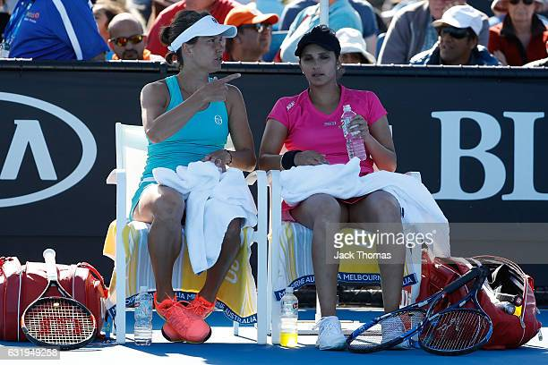 Sania Mirza of India and Barbora Strycova of the Czech Republic compete in their first round match against Joclyn Rae of Great Britain and Anna Smith...