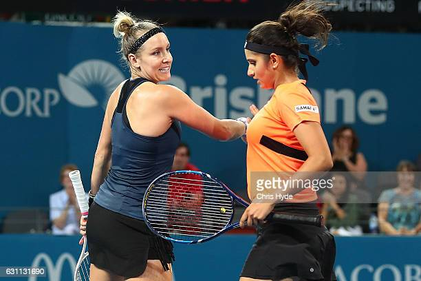 Sania Mirza of India and Bethanie MattekSands of the USA celebrate a point during the Women's Doubles Final against Ekaterina Makarova of Russia and...