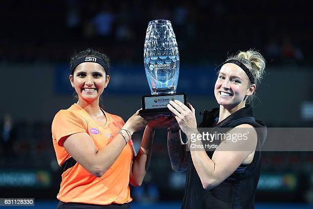 Sania Mirza of India and Bethanie MattekSands of the USA hold the winners trophy after the Women's Doubles Final against Ekaterina Makarova of Russia...