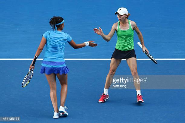 Sania Mirza of India and Cara Black of Zimbabwe in action in their fourth round doubles match against Sara Errani of Italy and Roberta Vinci of Italy...